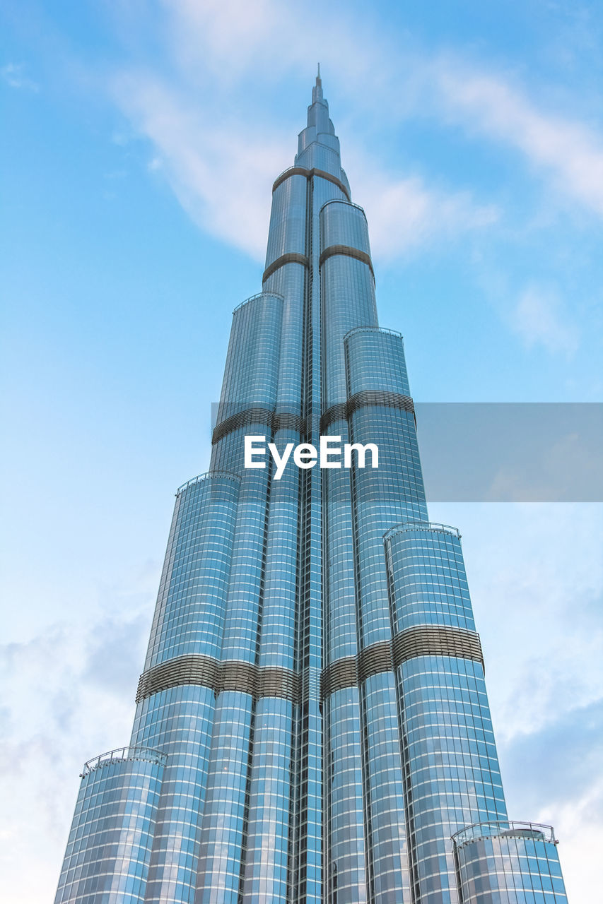 architecture, low angle view, built structure, building exterior, tower, sky, skyscraper, modern, day, cloud - sky, travel destinations, spirituality, tall, city, outdoors, no people