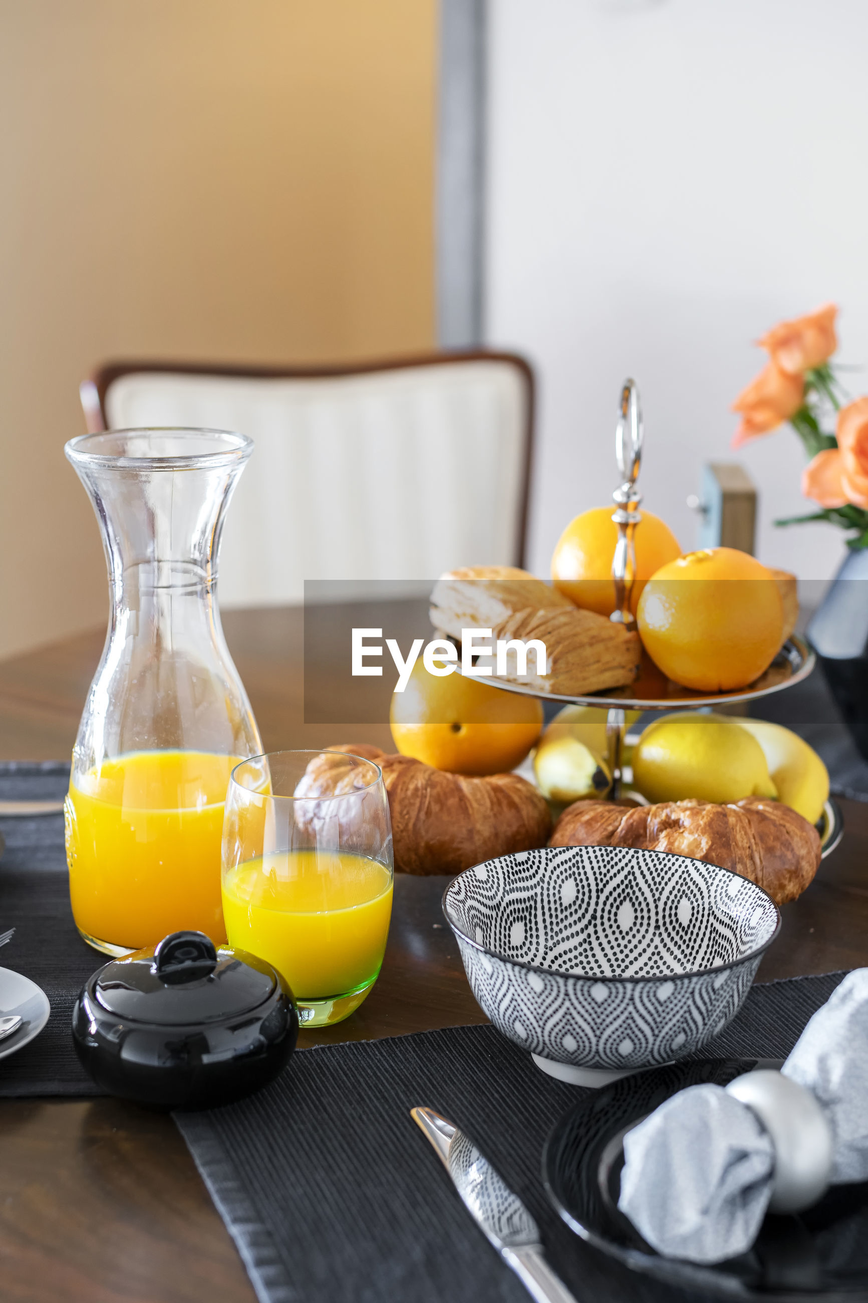 YELLOW AND FRUITS IN GLASS ON TABLE
