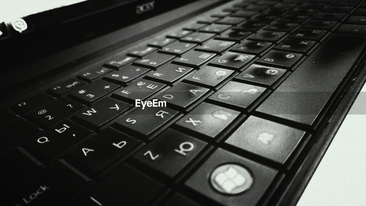 technology, computer keyboard, keyboard, computer key, alphabet, connection, indoors, text, laptop, computer, communication, close-up, no people, high angle view, wireless technology, computer equipment, day
