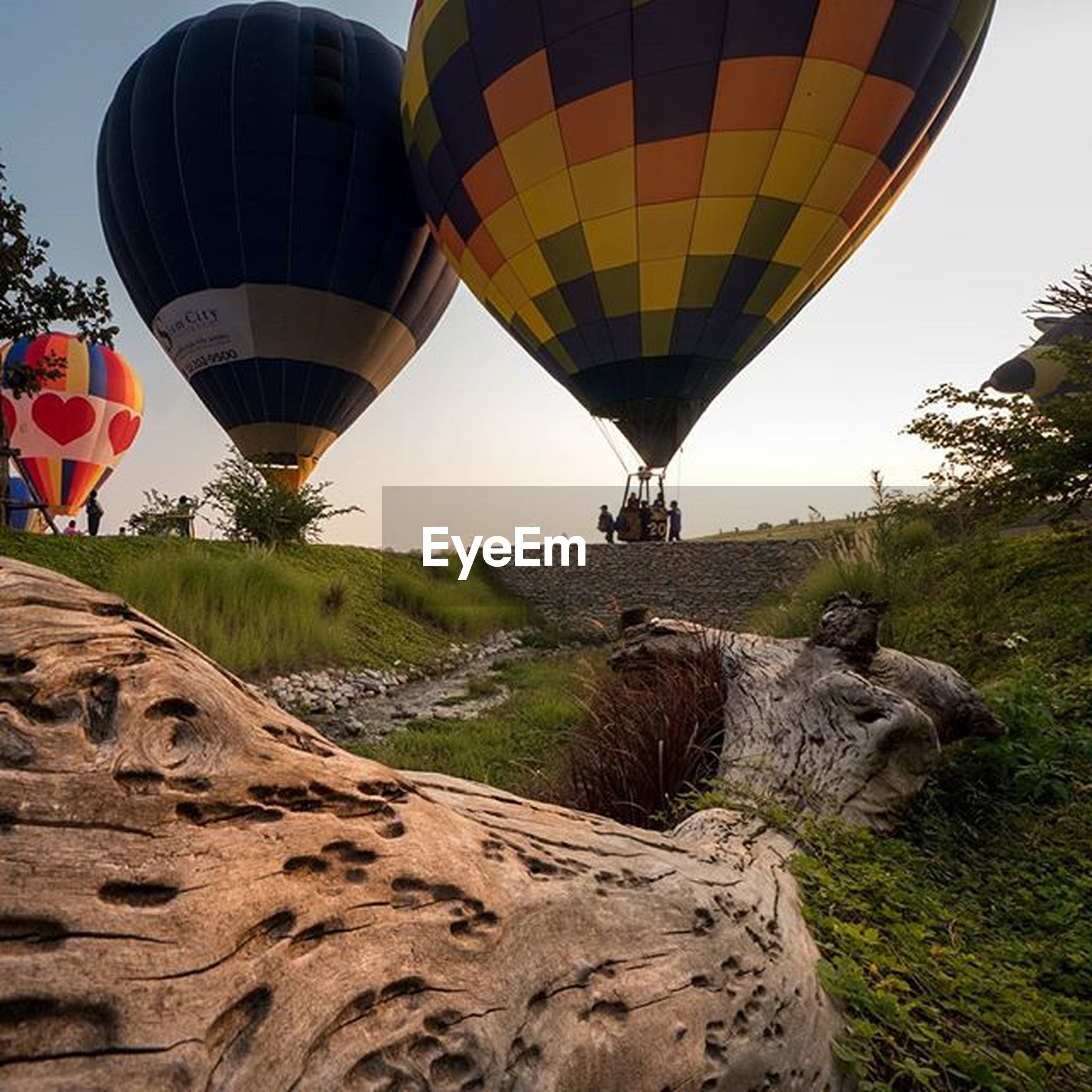 sky, built structure, landscape, architecture, clear sky, tranquility, tranquil scene, nature, scenics, day, tourism, travel destinations, travel, rock - object, outdoors, incidental people, transportation, hot air balloon, beauty in nature, mountain
