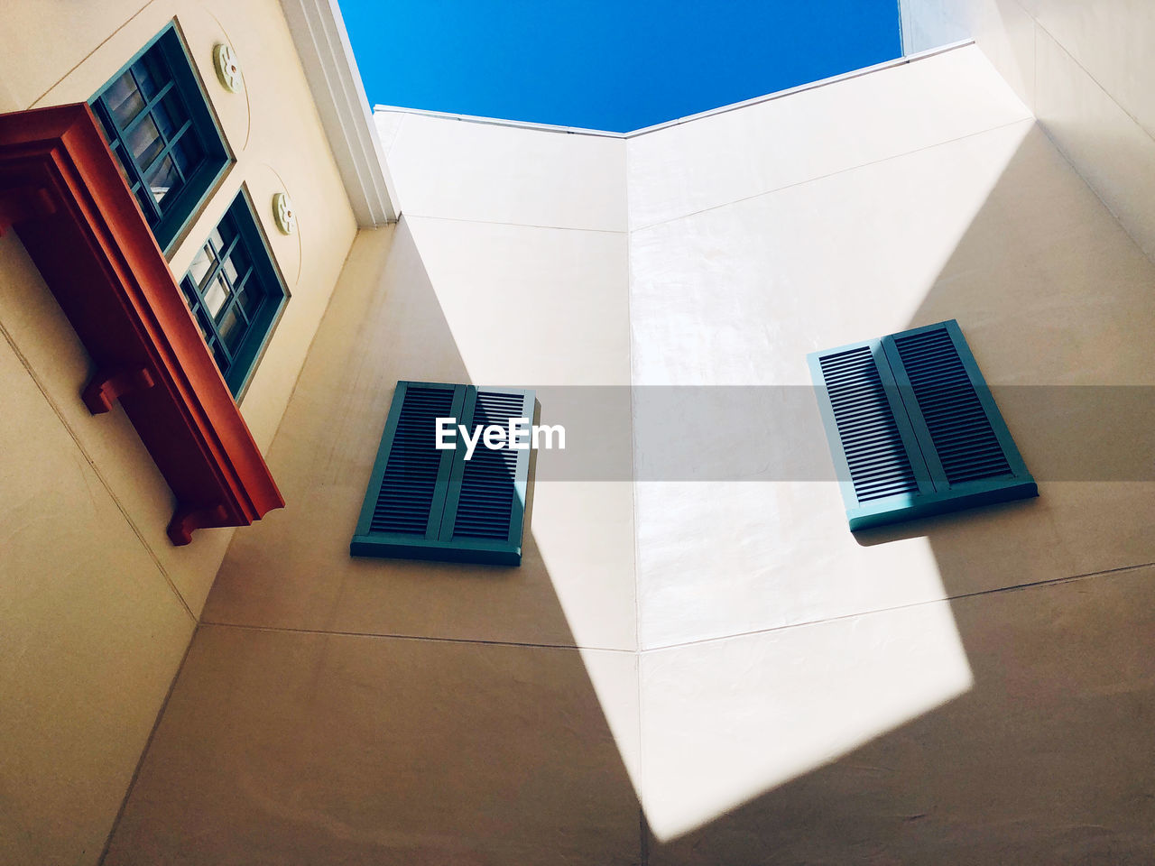 HIGH ANGLE VIEW OF WHITE BUILDING ON TABLE