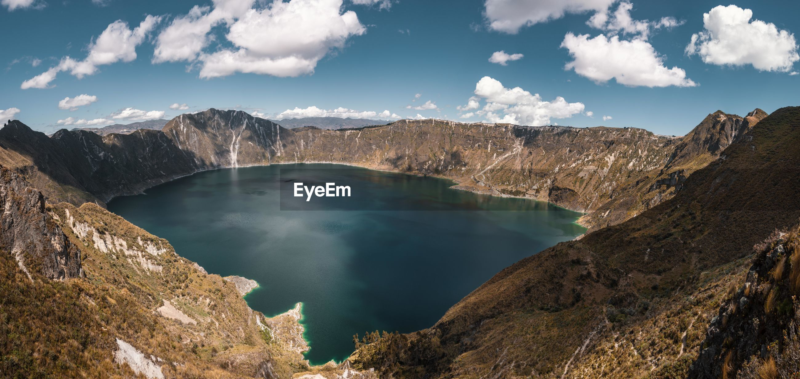 Made it to the crater lake of Quilotoa. Quilotoa South America Latin America Outdoors Day Hiking Adventure Non-urban Scene Remote Explore Discover  Nature Mountain Water Scenics Beatuy In Nature Crater Crater Lake Surface Panorama Idyllic Tranquility High Angle View No People Travel Destinations