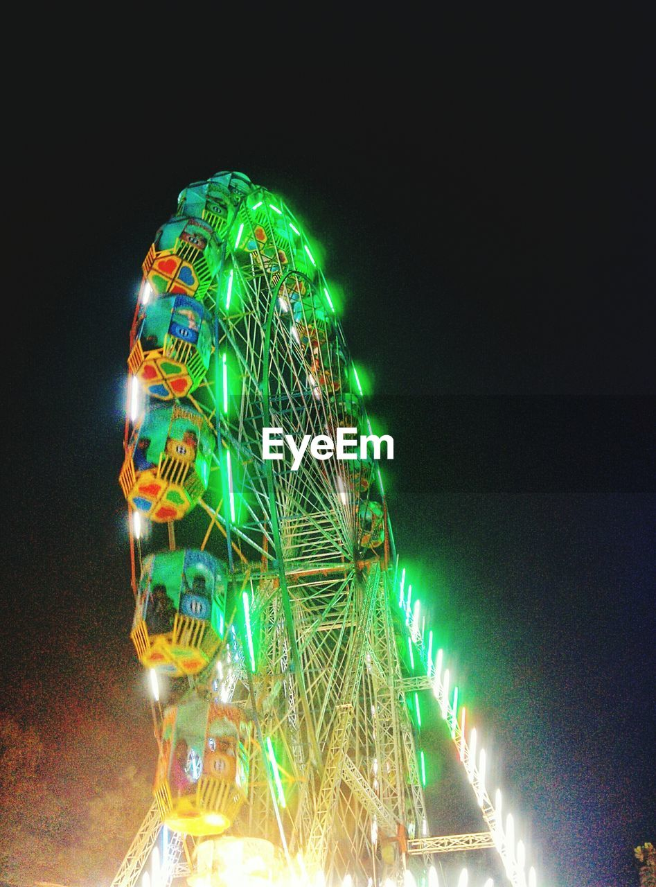 night, illuminated, arts culture and entertainment, amusement park, ferris wheel, low angle view, no people, multi colored, amusement park ride, clear sky, christmas, christmas decoration, big wheel, outdoors, sky, close-up