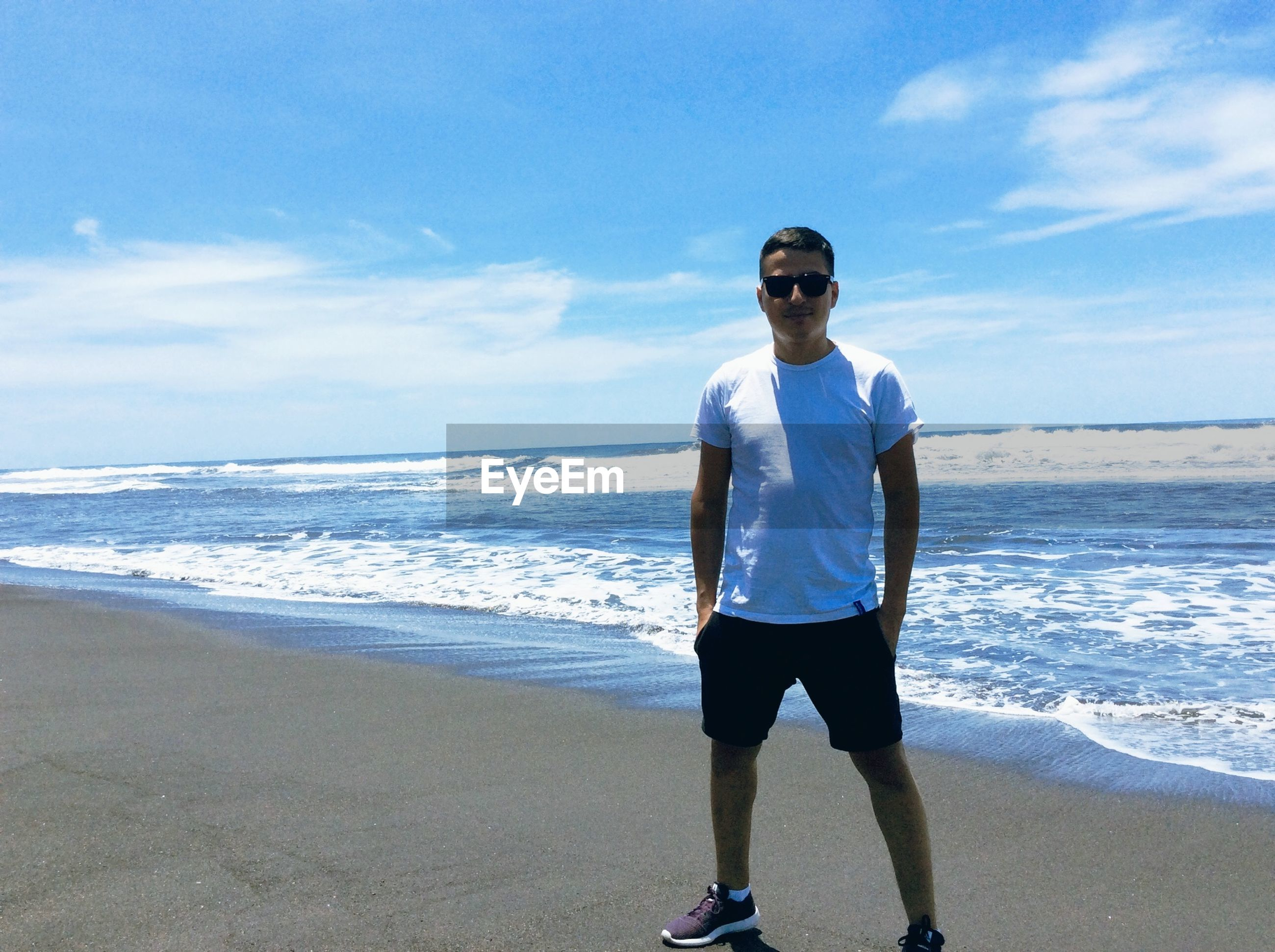 beach, sea, shore, horizon over water, water, sky, full length, sand, lifestyles, casual clothing, leisure activity, standing, person, vacations, front view, rear view, scenics, looking at camera