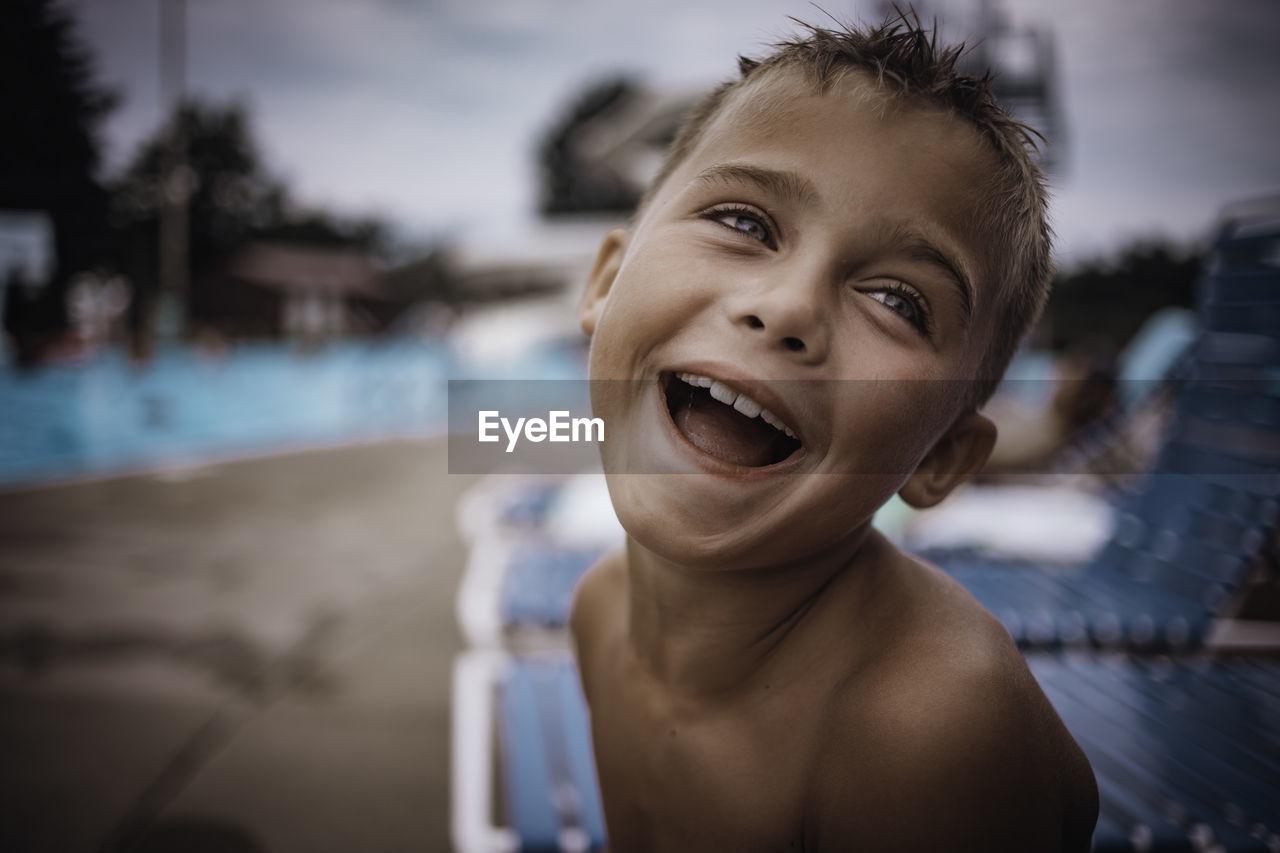 Portrait of smiling boy at poolside