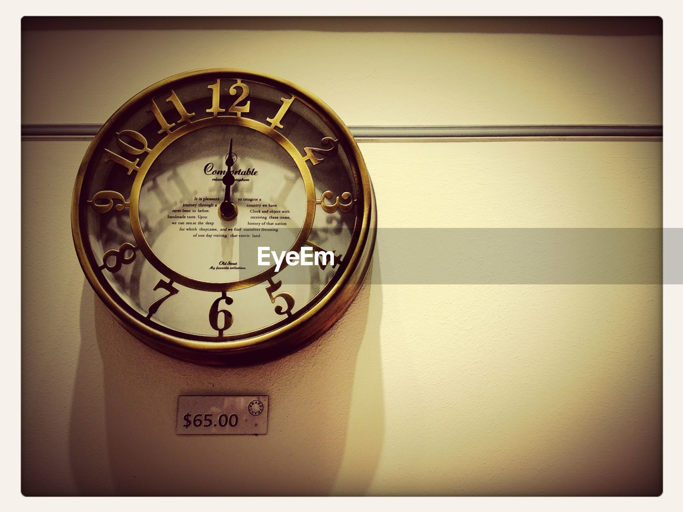 indoors, clock, time, number, transfer print, clock face, communication, old-fashioned, close-up, accuracy, technology, auto post production filter, wall clock, wall - building feature, low angle view, circle, retro styled, minute hand, text, single object