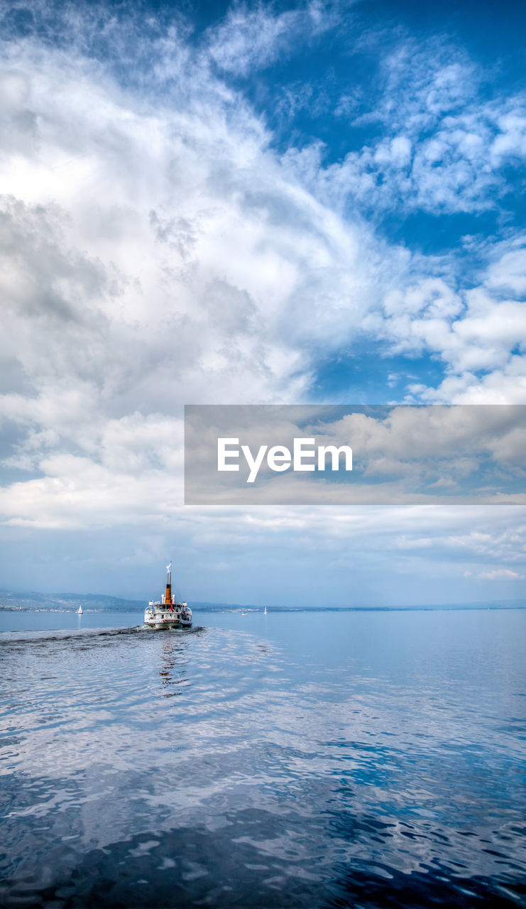 cloud - sky, sea, sky, water, nature, nautical vessel, scenics, horizon over water, transportation, tranquility, beauty in nature, tranquil scene, waterfront, outdoors, day, mode of transport, men, sailing, people