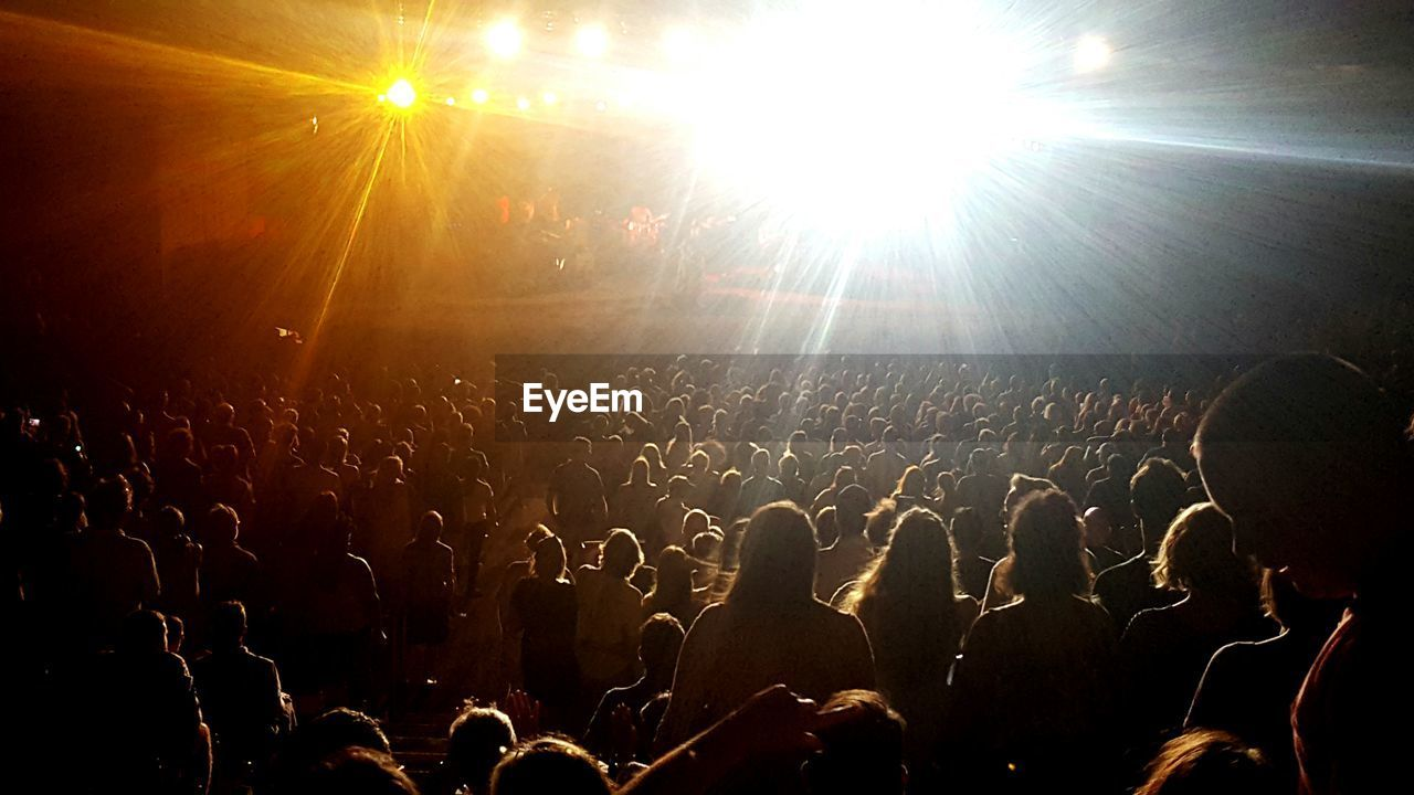 REAR VIEW OF PEOPLE ENJOYING AT CONCERT