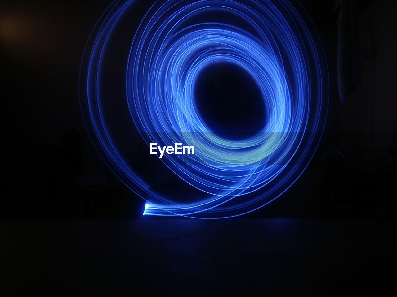 illuminated, long exposure, glowing, motion, light painting, night, light - natural phenomenon, light trail, spinning, indoors, speed, blurred motion, wire wool, pattern, blue, spiral, creativity, no people, shape, abstract, light, electricity, black background, electrical equipment