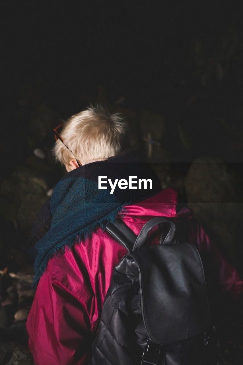 rear view, real people, one person, lifestyles, leisure activity, blond hair, outdoors, warm clothing, nature, night, mammal, people