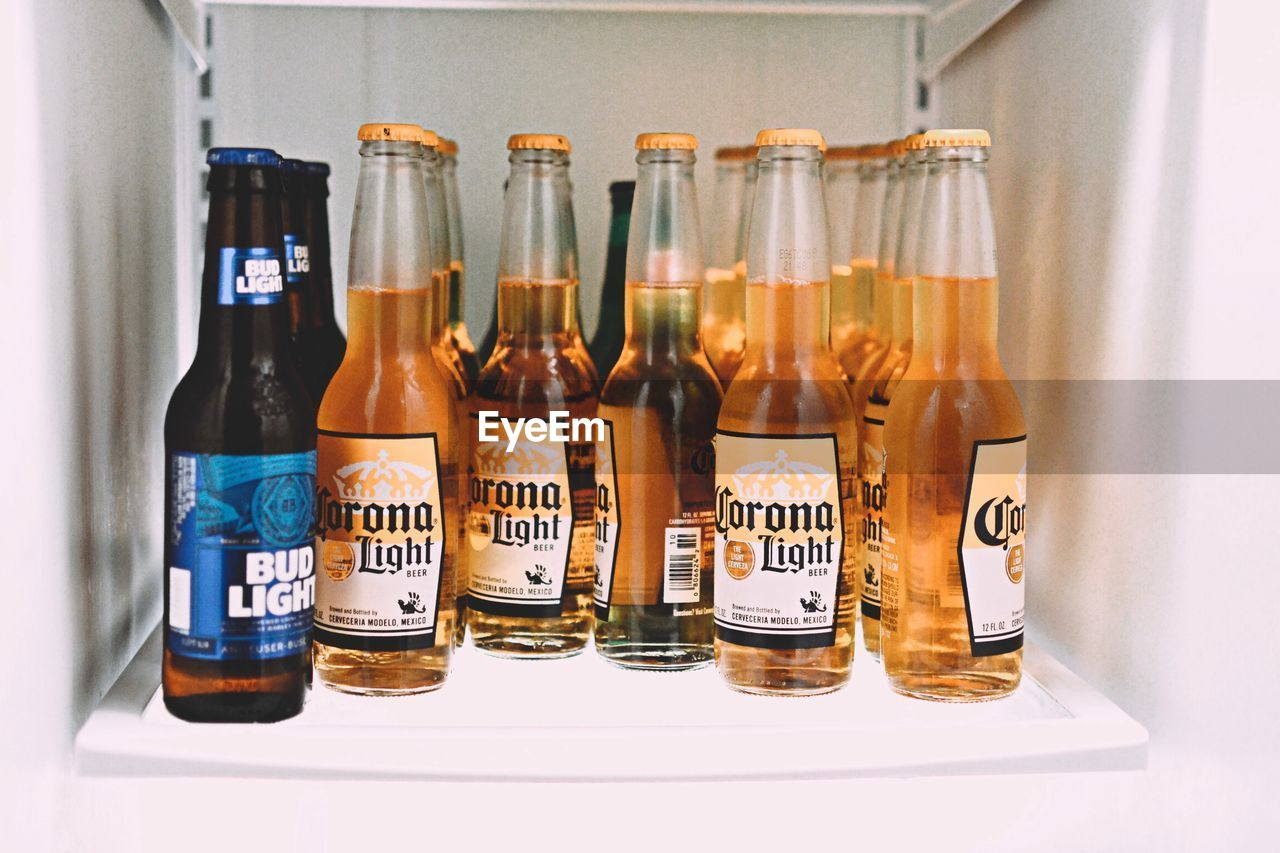 bottle, indoors, text, label, alcohol, large group of objects, no people, food and drink, variation, drink, liqueur, close-up, day