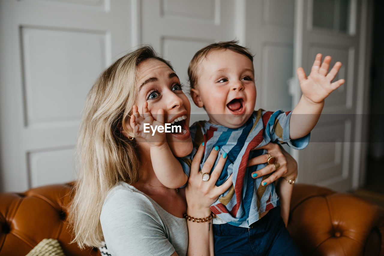 Cheerful Mother With Son At Home
