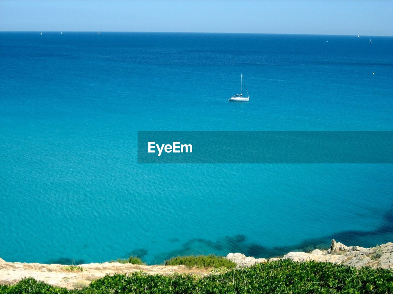 High angle view of sailboat in calm sea