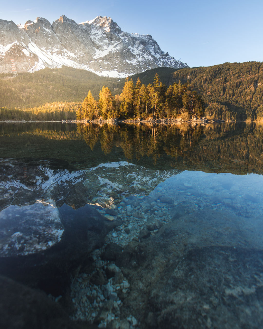 water, beauty in nature, mountain, scenics - nature, tranquil scene, tranquility, sky, rock, lake, nature, solid, non-urban scene, rock - object, day, no people, mountain range, reflection, idyllic, environment, outdoors, flowing water, mountain peak