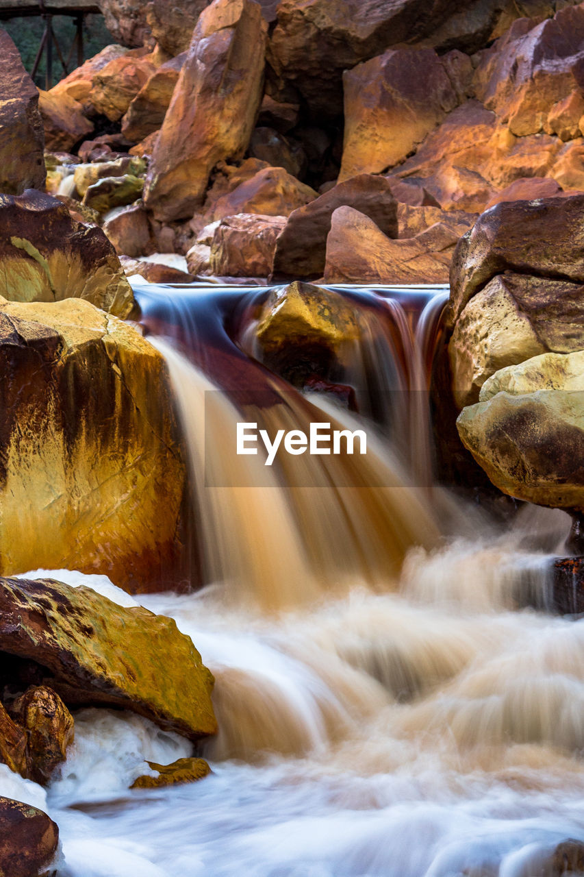 rock, rock - object, solid, scenics - nature, water, beauty in nature, motion, long exposure, waterfall, rock formation, flowing water, blurred motion, non-urban scene, no people, nature, flowing, day, travel destinations, river, outdoors, power in nature, stream - flowing water, falling water