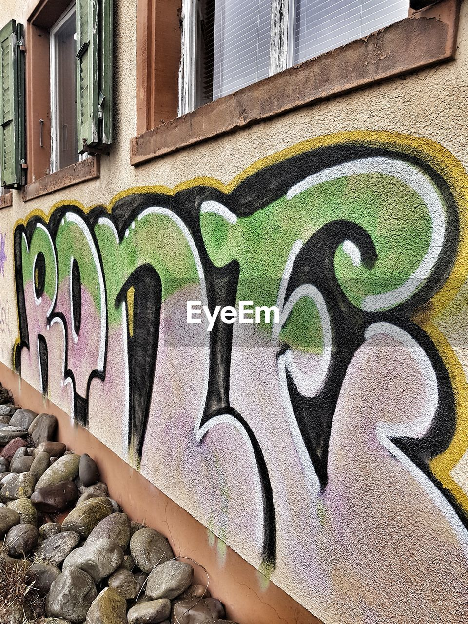 graffiti, art and craft, architecture, street art, built structure, building exterior, creativity, outdoors, day, multi colored, no people, city, close-up