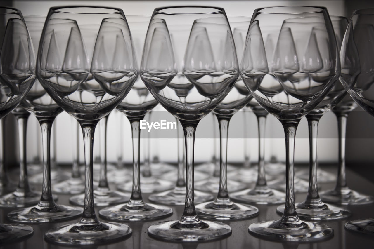 Close-Up Of Wine Glasses Arranging On Table
