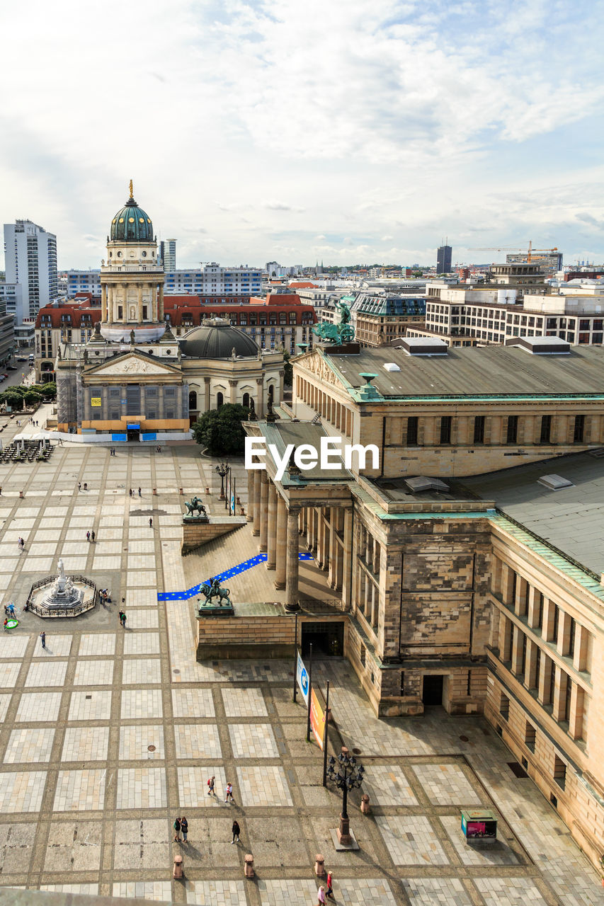 architecture, building exterior, built structure, high angle view, sky, city, outdoors, day, cloud - sky, real people, cityscape