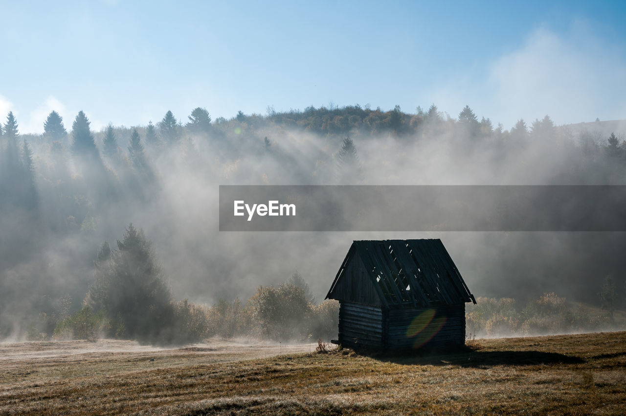 landscape, architecture, sky, smoke - physical structure, environment, built structure, land, nature, field, day, building exterior, no people, scenics - nature, house, fog, tree, barn, rural scene, non-urban scene, agricultural building, outdoors