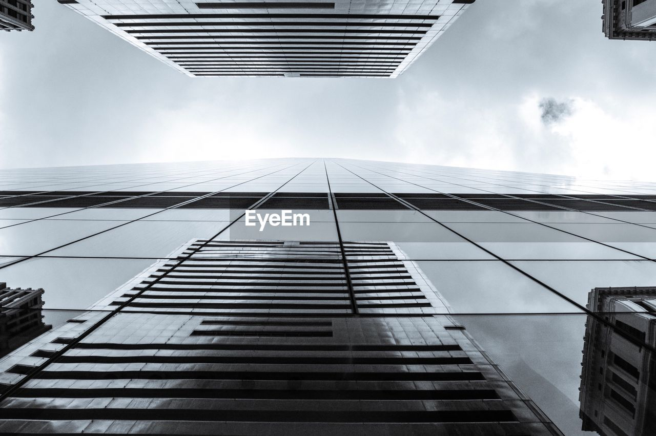 architecture, building exterior, skyscraper, modern, built structure, city, tall, corporate business, low angle view, growth, reflection, outdoors, no people, city life, sky, day
