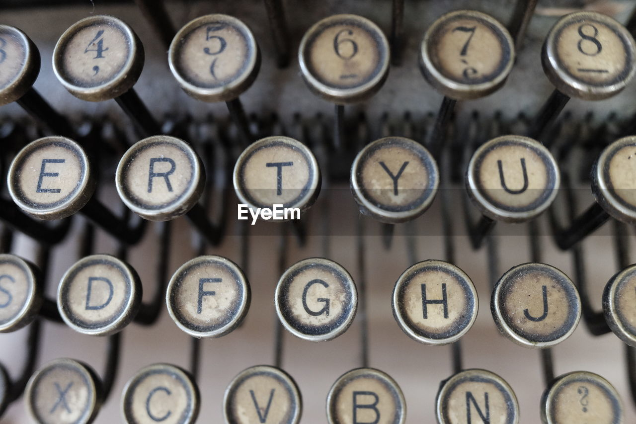 typewriter, letter, indoors, text, number, retro styled, alphabet, technology, no people, obsolete, antique, in a row, full frame, close-up, communication, old, backgrounds, capital letter, metal, dirty, computer key, push button, orthographic symbol, keyboard