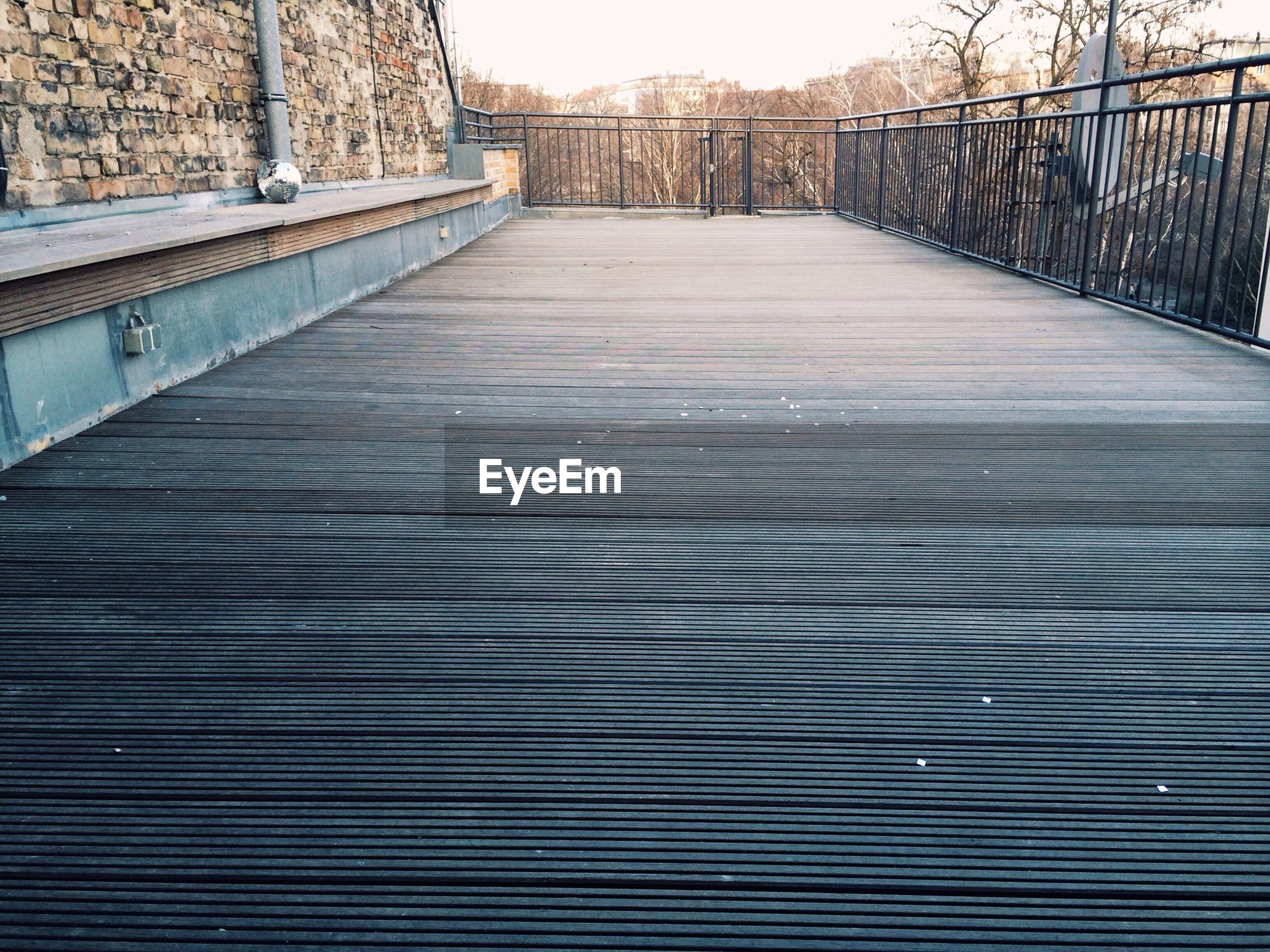 Surface level of walkway along railings