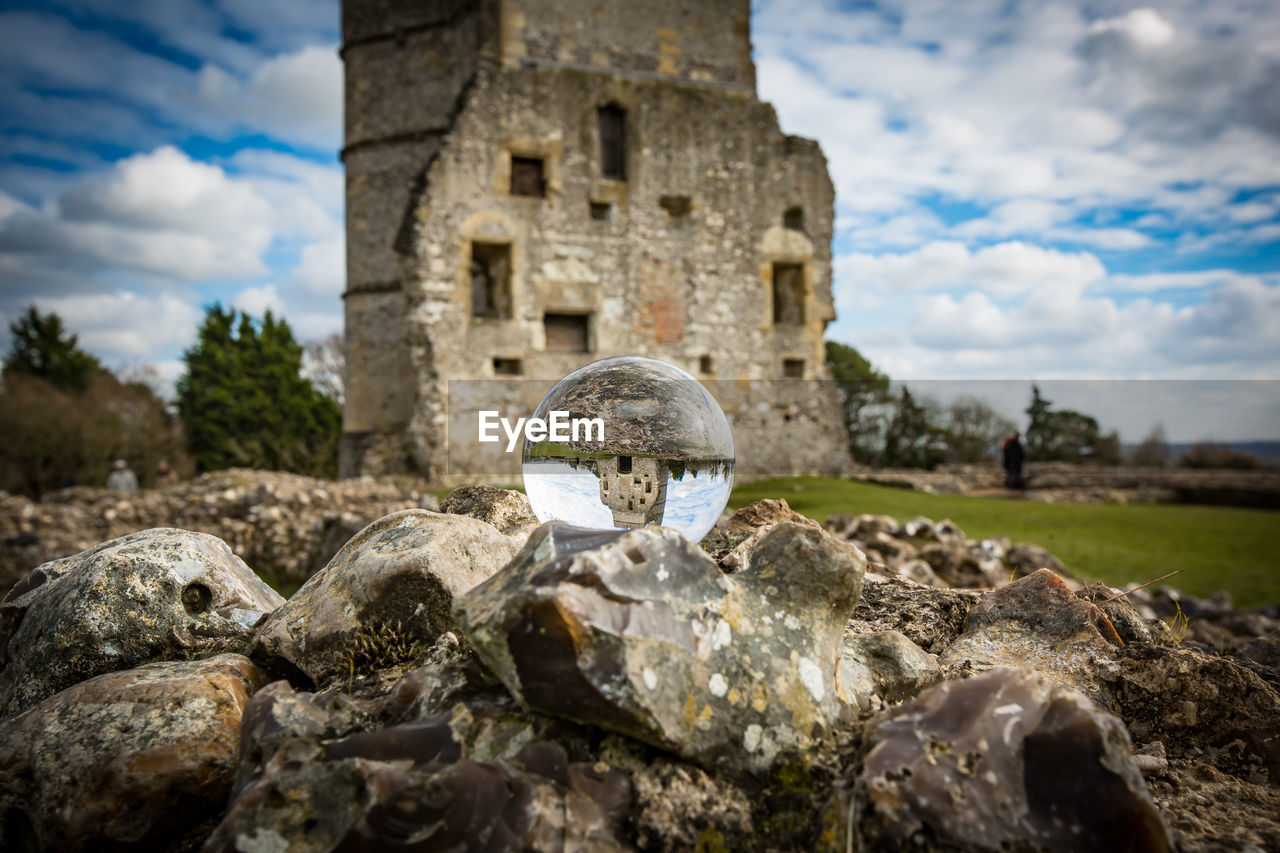 history, architecture, the past, sky, cloud - sky, solid, no people, built structure, nature, day, rock, rock - object, ancient, building, focus on foreground, selective focus, outdoors, building exterior, land, stone