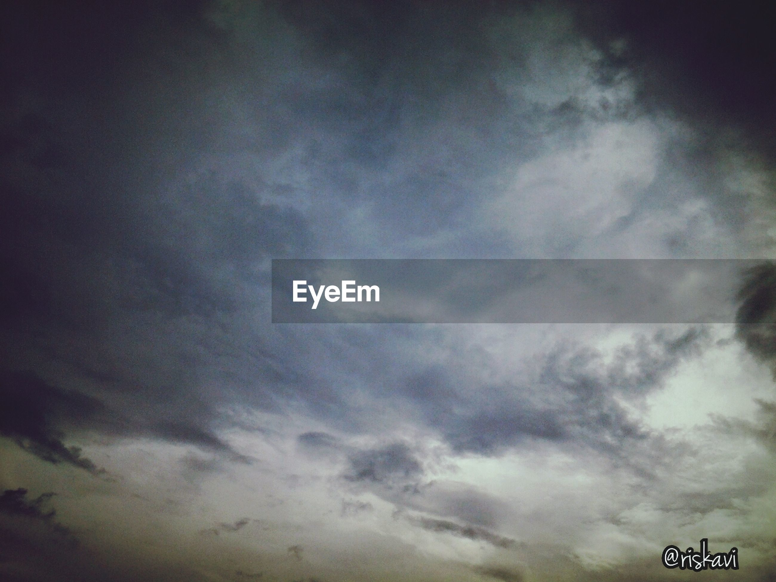 sky, low angle view, cloud - sky, cloudy, weather, nature, overcast, cloudscape, beauty in nature, tranquility, cloud, scenics, no people, outdoors, dusk, day, storm cloud, tranquil scene, backgrounds, dramatic sky