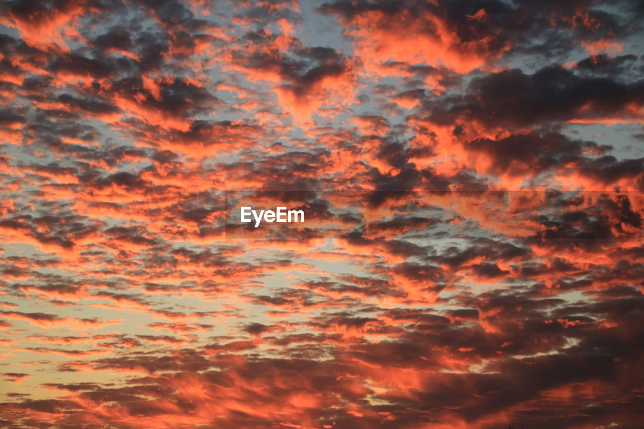 cloud - sky, orange color, beauty in nature, sky, sunset, tranquility, backgrounds, tranquil scene, full frame, scenics - nature, no people, dramatic sky, idyllic, low angle view, nature, outdoors, cloudscape, pattern, textured, romantic sky