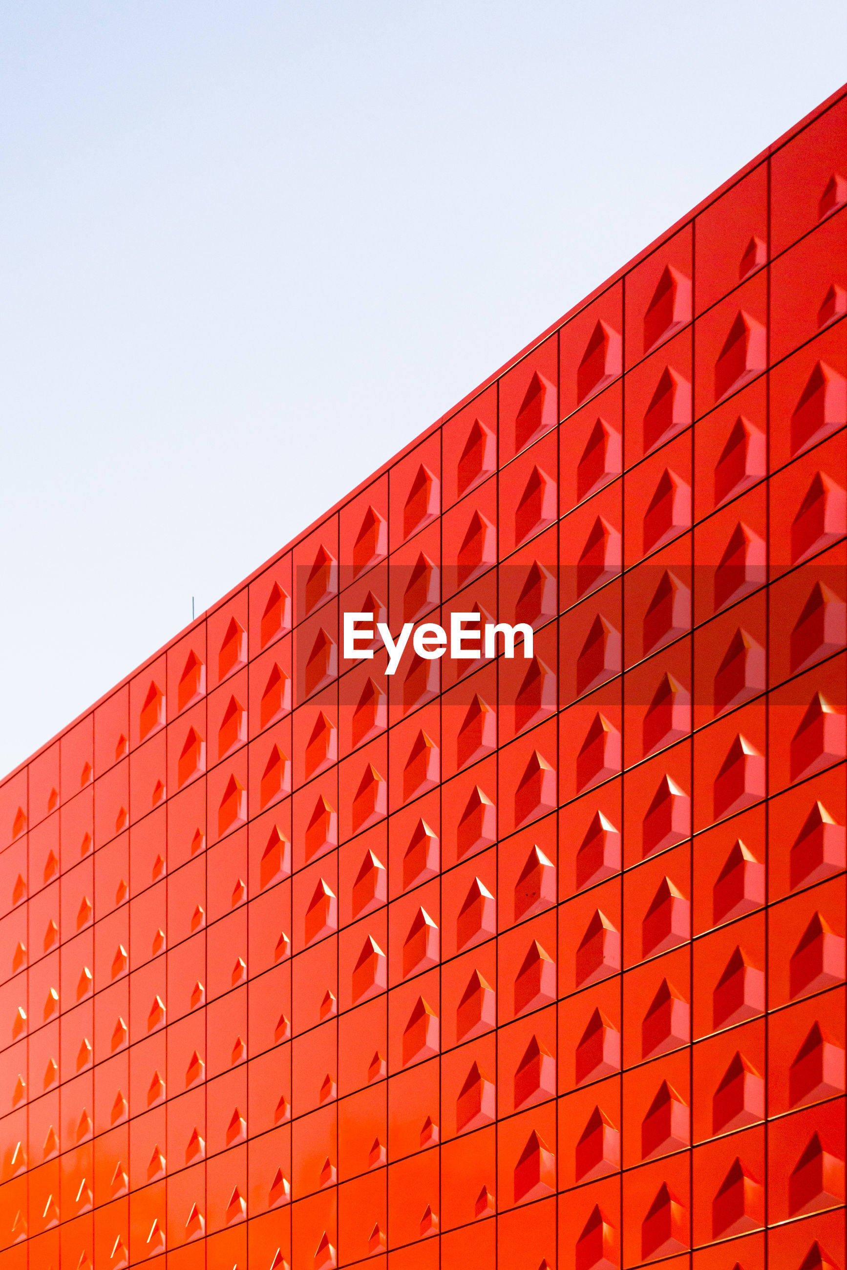 LOW ANGLE VIEW OF RED BRICK WALL AGAINST BUILDING