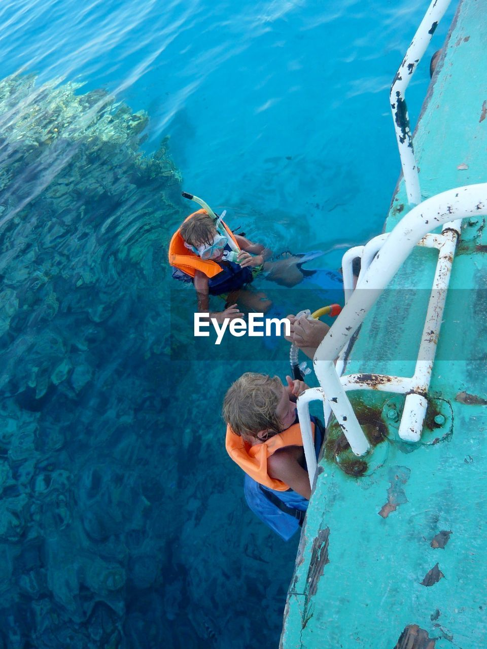 High angle view of boys snorkeling in sea