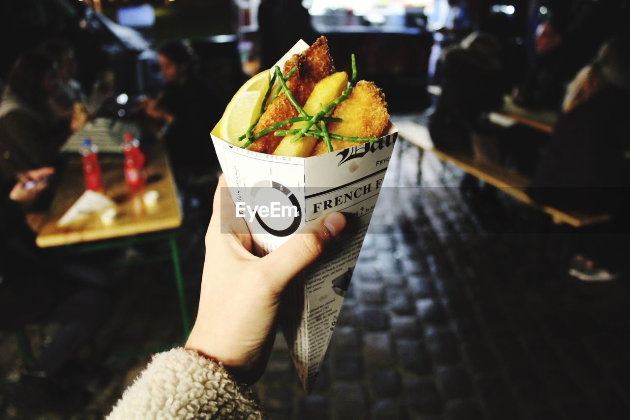human hand, food and drink, human body part, real people, incidental people, one person, holding, human finger, food, freshness, focus on foreground, lifestyles, men, women, drink, close-up, day, indoors, ready-to-eat, people