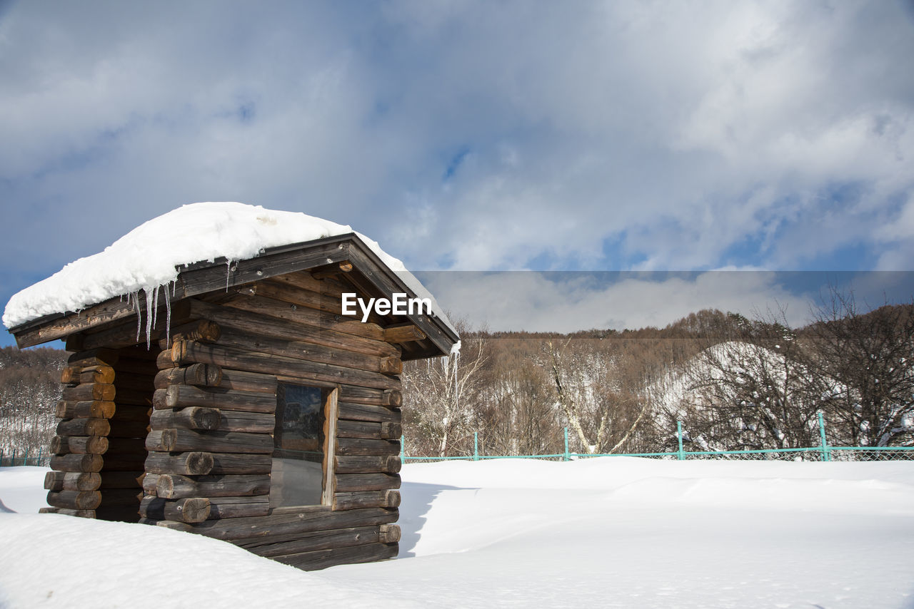 HOUSE ON FIELD DURING WINTER