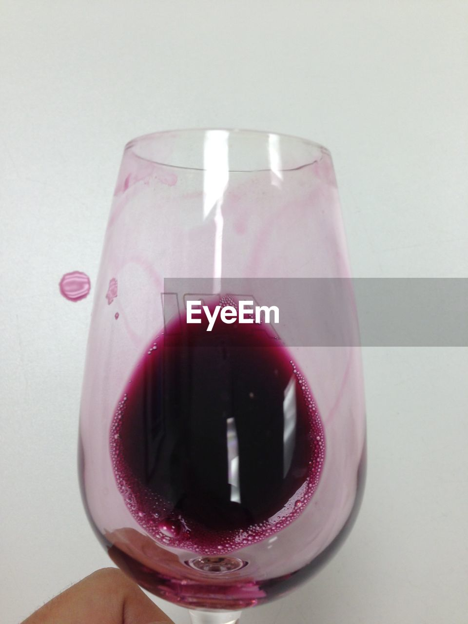 drink, food and drink, refreshment, close-up, drinking glass, pink color, freshness, drinking straw, one person, red, food, cola, ice cube, human body part, white background, smoothie, alcohol, studio shot, real people, wineglass, indoors, human hand, day, people