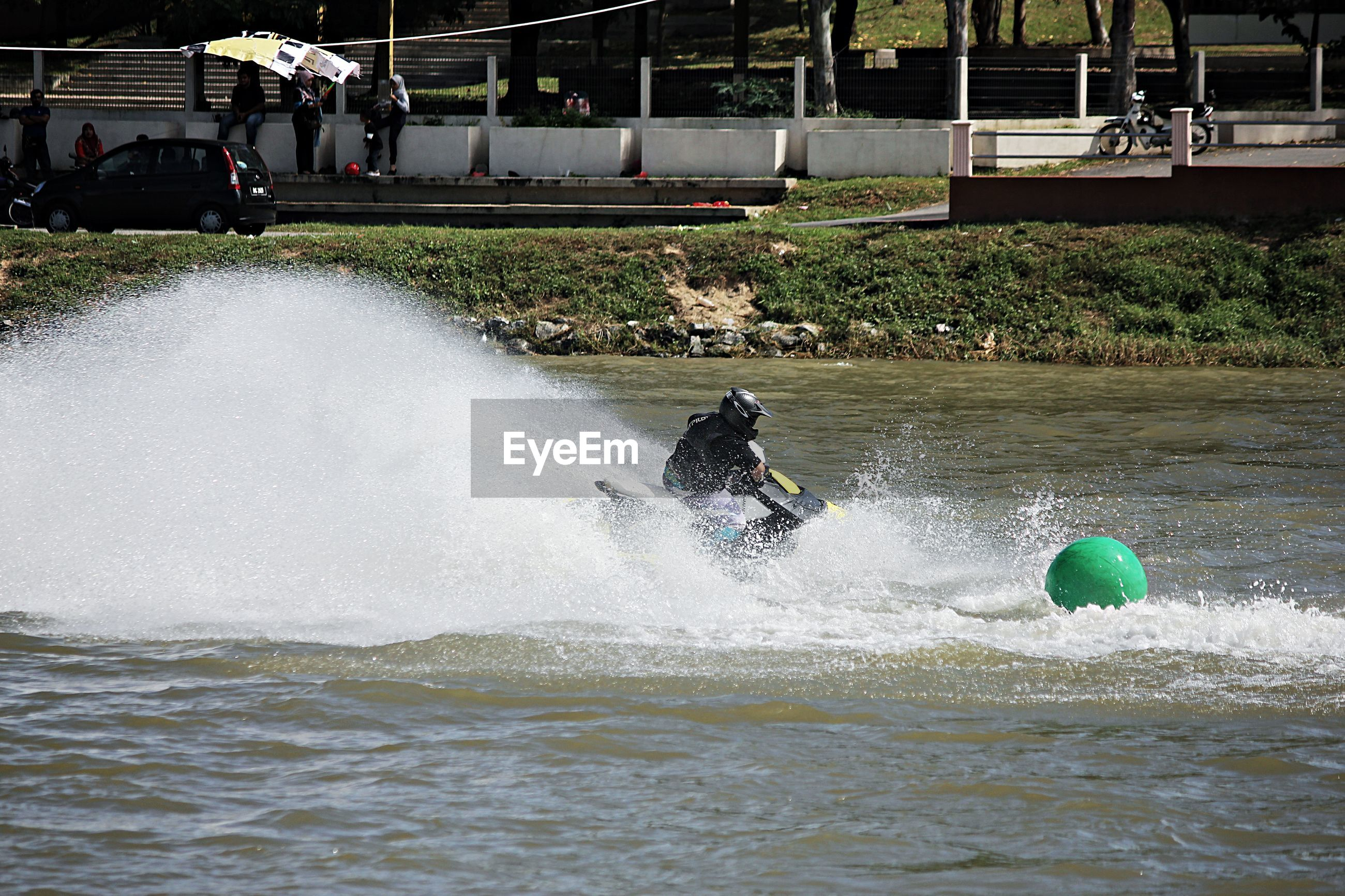 Person riding jet boat in lake