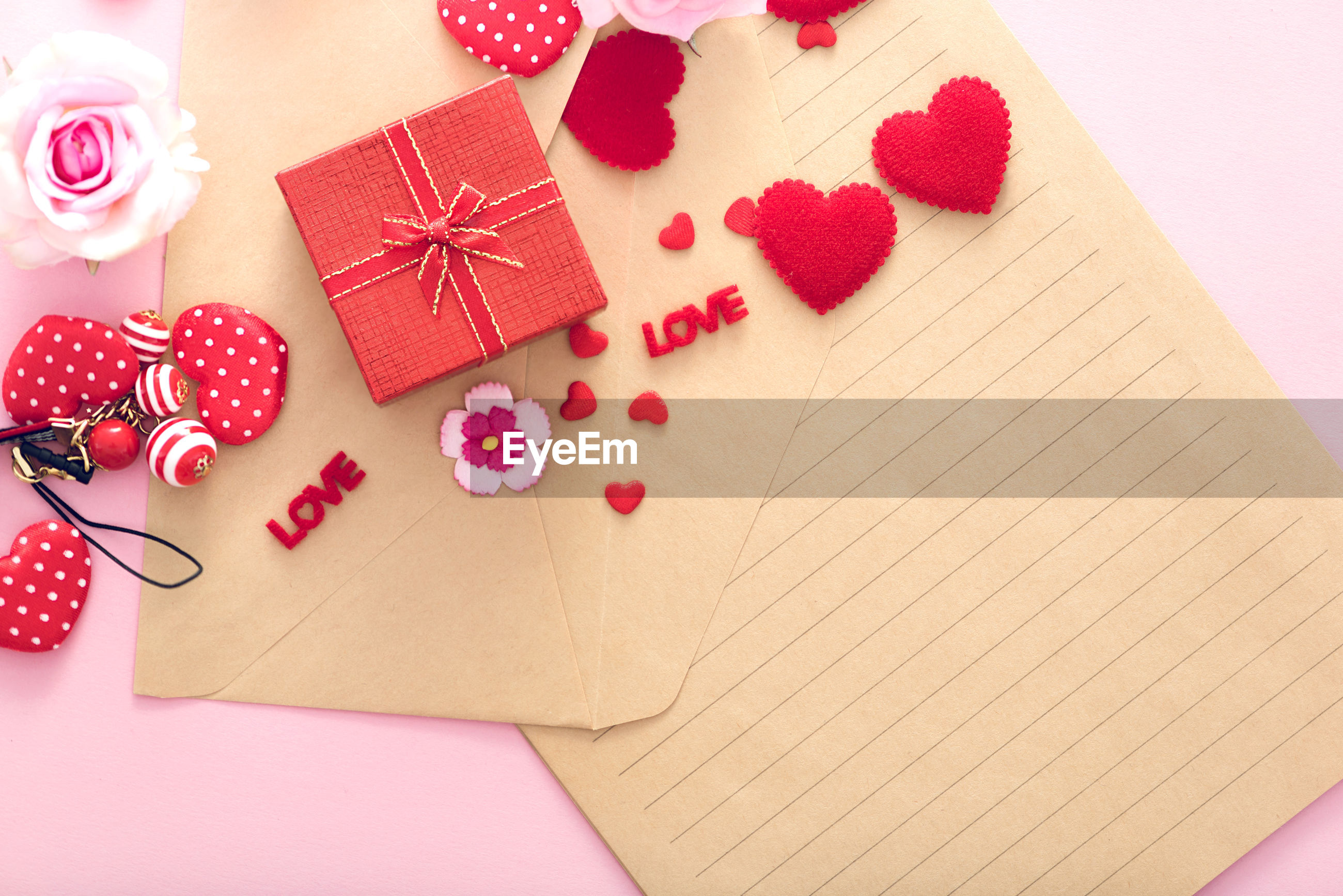 High angle view of valentines decoration against pink background