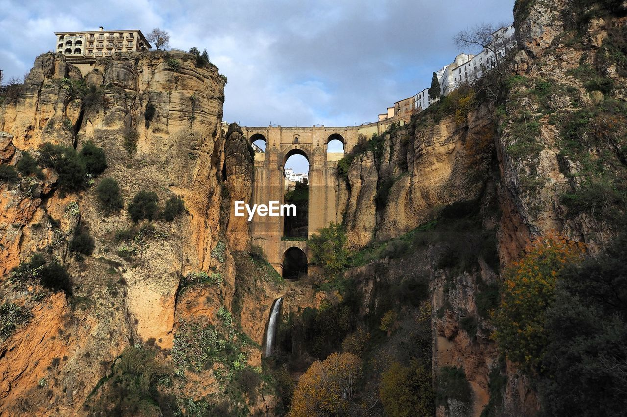 architecture, history, the past, built structure, arch, ancient, sky, travel destinations, old ruin, day, nature, travel, rock formation, plant, rock, tourism, ancient civilization, rock - object, solid, ruined, no people, outdoors, archaeology, bridge - man made structure