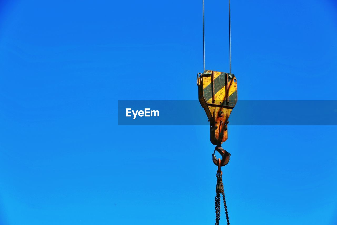 blue, sky, clear sky, copy space, low angle view, no people, nature, day, metal, cable, connection, outdoors, rope, lighting equipment, technology, electricity, hanging, sunlight, close-up, crane - construction machinery, construction equipment, power supply