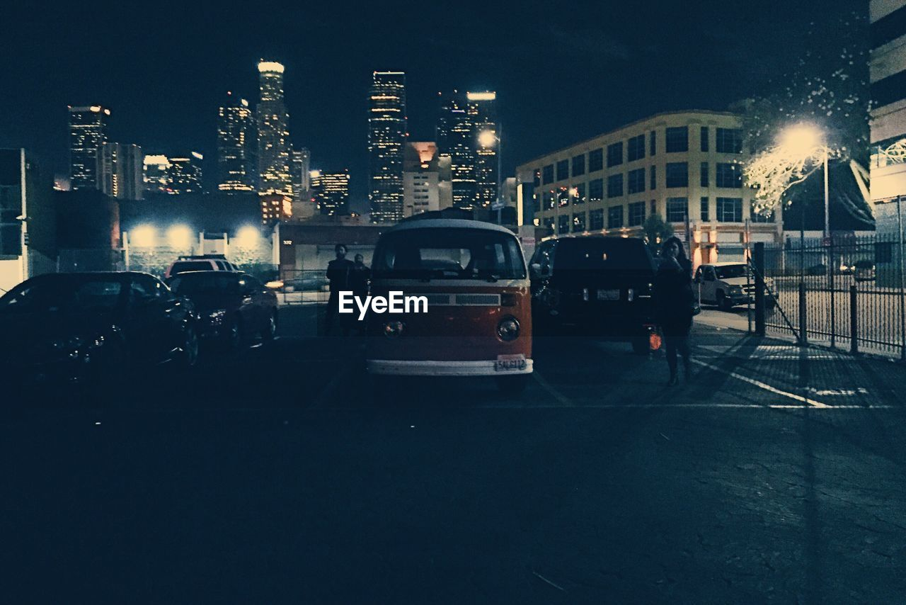architecture, building exterior, built structure, land vehicle, illuminated, night, city, transportation, mode of transport, outdoors, no people, cityscape, sky
