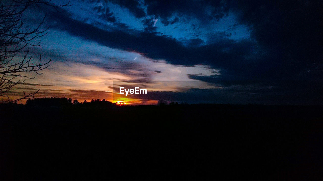 sky, cloud - sky, sunset, silhouette, tranquil scene, tranquility, beauty in nature, scenics - nature, environment, nature, landscape, no people, orange color, idyllic, dark, dramatic sky, outdoors, majestic, dusk, non-urban scene