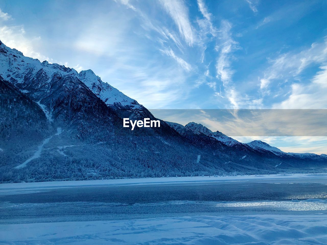 beauty in nature, scenics - nature, sky, winter, mountain, cold temperature, cloud - sky, tranquil scene, snow, tranquility, water, environment, non-urban scene, nature, waterfront, idyllic, landscape, no people, mountain range, snowcapped mountain, ice, mountain peak