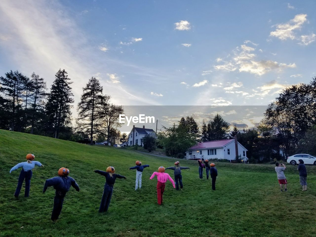 large group of people, grass, tree, sky, real people, nature, cloud - sky, men, enjoyment, field, leisure activity, girls, outdoors, beauty in nature, togetherness, lifestyles, scenics, landscape, playing, women, vacations, day, growth, childhood, building exterior, people