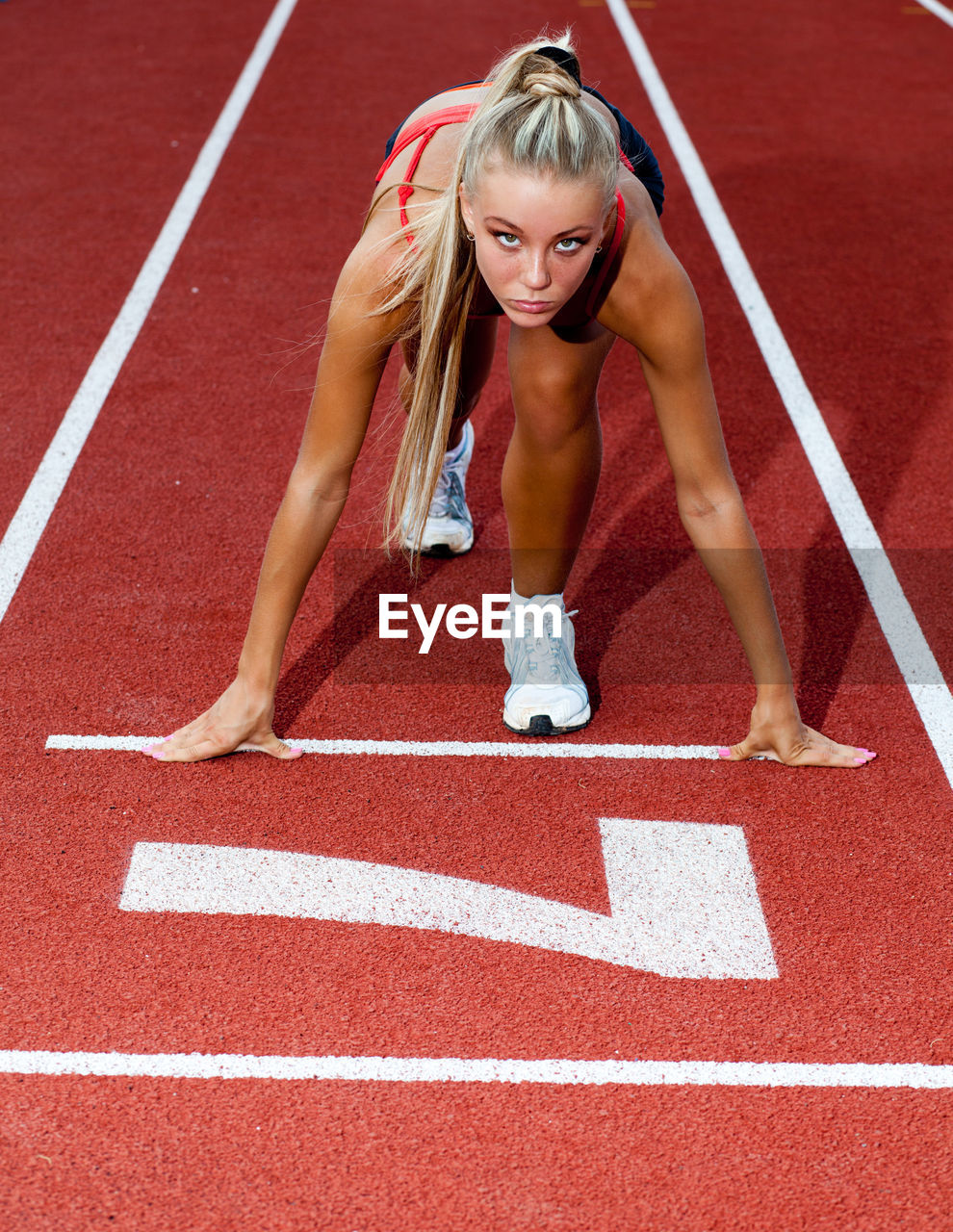 track and field, running track, sport, running, competition, women, exercising, sports race, healthy lifestyle, athlete, sports track, young adult, track and field athlete, starting line, females, one person, adult, competitive sport, young women, beautiful woman, track starting block, effort