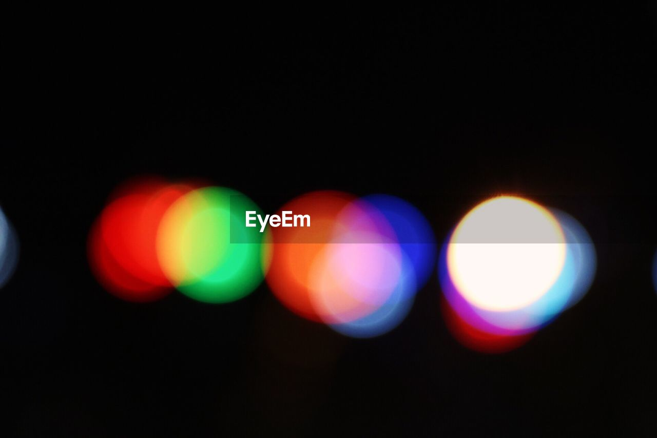 illuminated, night, circle, lighting equipment, light effect, glowing, no people, defocused, red, outdoors, multi colored, disco lights, close-up, projection equipment