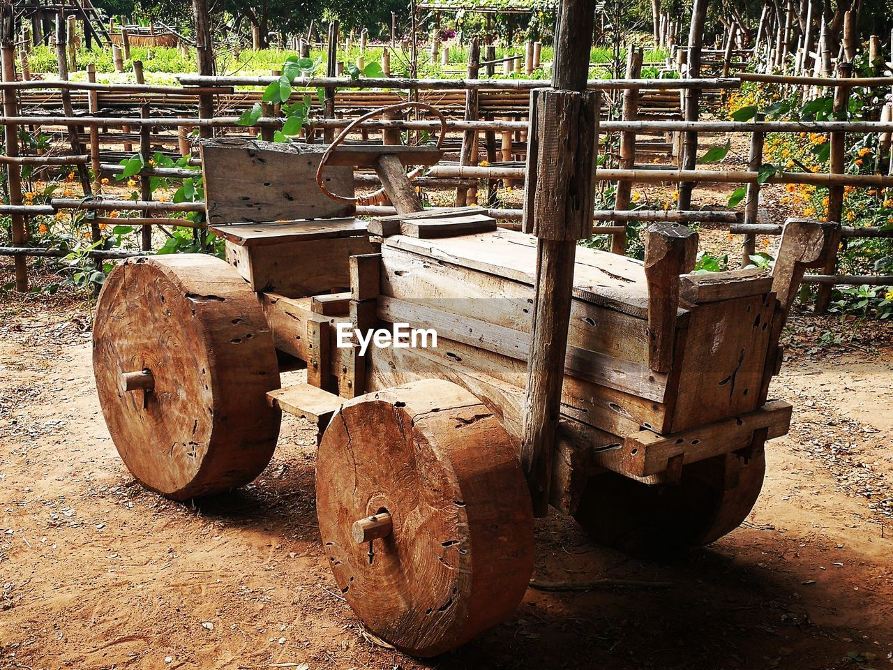 wood - material, no people, cart, day, wheel, transportation, nature, mode of transportation, land, outdoors, tree, damaged, field, abandoned, empty, rusty, seat, absence, old, obsolete