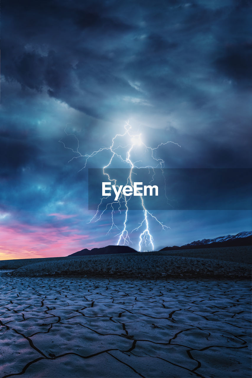 cloud - sky, lightning, storm, sky, beauty in nature, power in nature, thunderstorm, scenics - nature, storm cloud, power, dramatic sky, nature, water, forked lightning, no people, mountain, land, overcast, outdoors, light