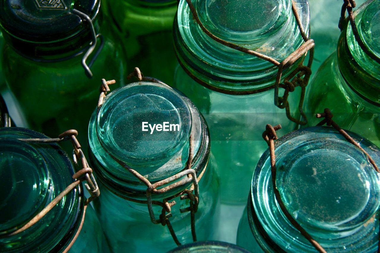Full frame shot of old empty bottles