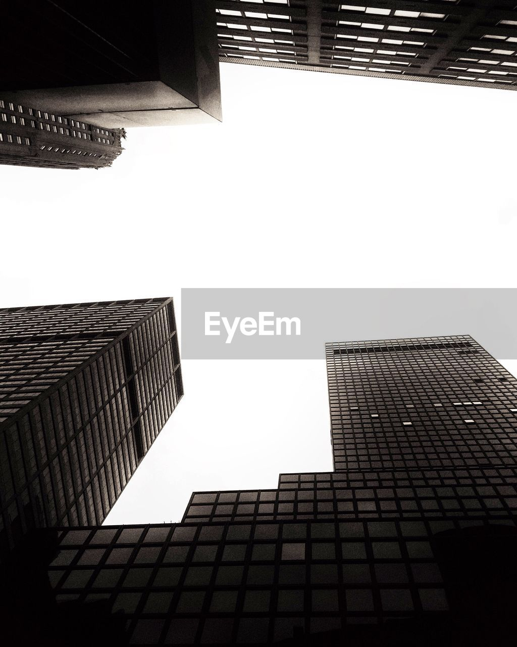 architecture, low angle view, building exterior, built structure, skyscraper, no people, modern, tall, clear sky, day, outdoors, city, sky