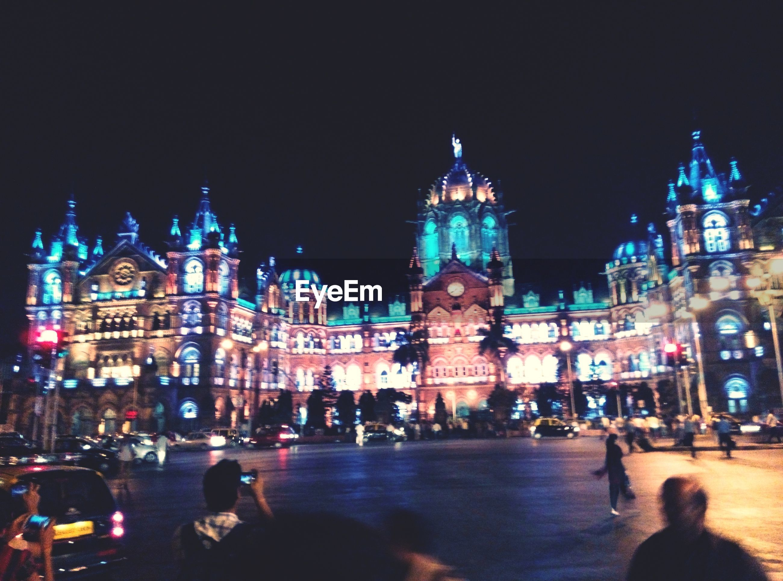 illuminated, building exterior, architecture, night, built structure, city, large group of people, incidental people, city life, street, travel destinations, lifestyles, religion, men, famous place, city street, leisure activity, person