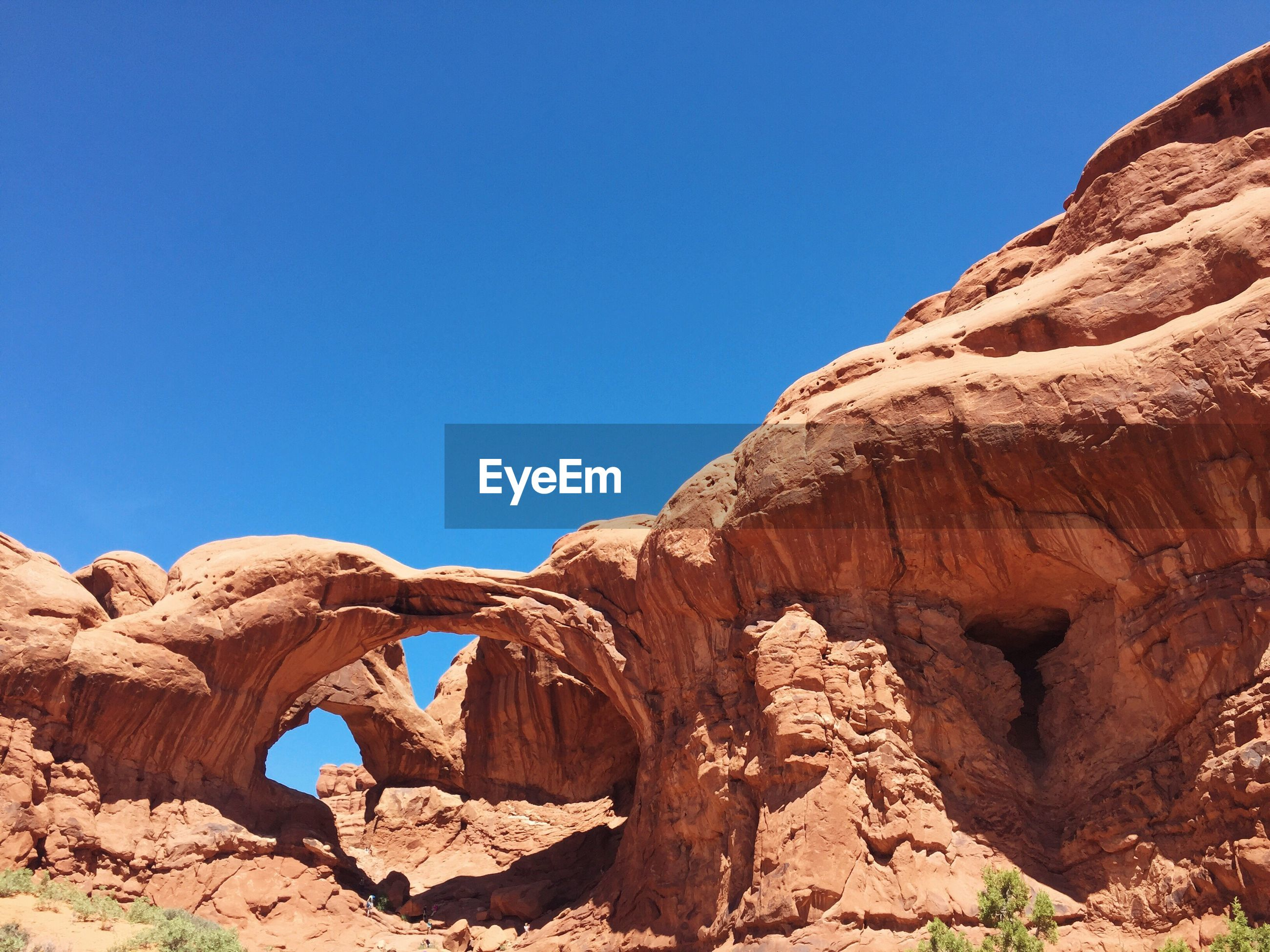 Double arch against clear blue sky at arches national park